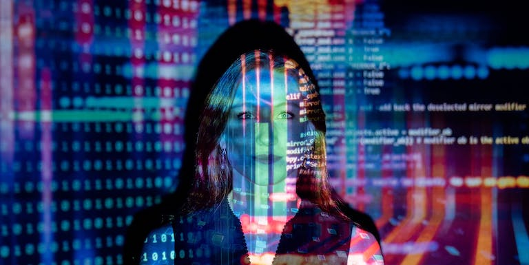 Women with data projected in light across her