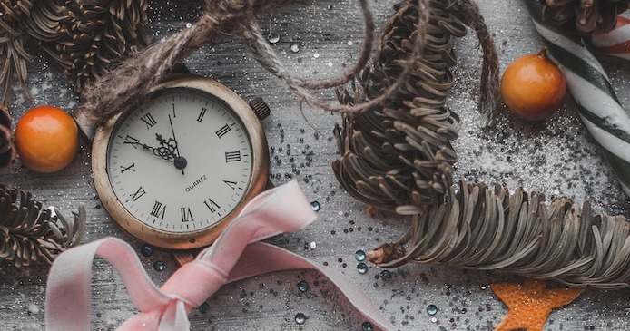 clock, fir cones and festive decorations
